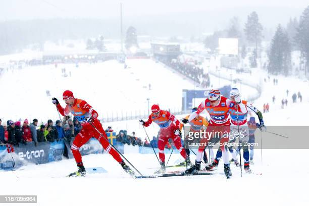 Sergey Ustiugov of Russia takes 1st place Andrey Melnichenko of Russia takes 2nd place Finn Haagen Krogh of Norway takes 3rd place during the FIS...