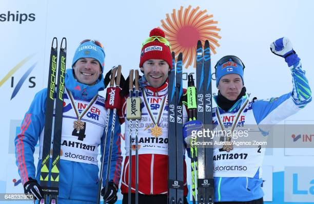 Sergey Ustiugov of Russia wins the silver medal Alex Harvey of Canada wins the gold medal Matti Heikkinen of Finland wins the bronze medal during the...