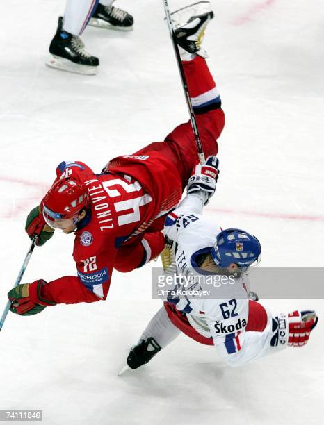 Sergey Zinoviev of Russia fights for the puck with Czech's Petr Tenkrat during the IIHF World Ice Hockey Championship quarter final match between...