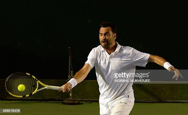 Sergi Bruguera of Mumbai Tennis Masters plays a shot against Punjab Marshals player Leander Paes during their Champions Tennis League match at the...