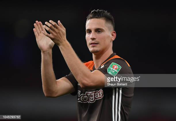 Sergi Canos of Brentford acknowledges the fans at the end of the Carabao Cup Third Round match between Arsenal and Brentford at Emirates Stadium on...