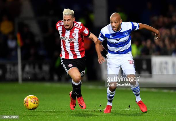 Sergi Canos of Brentford and Alex Baptiste of Queens Park Rangers during the Sky Bet Championship match between Queens Park Rangers and Brentford at...