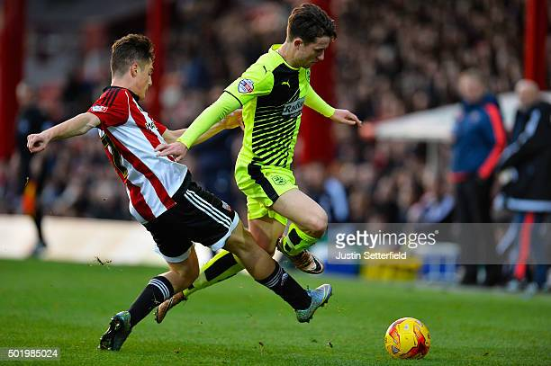 Sergi Canos of Brentford and Ben Chilwell of Huddersfield Town in action during the Sky Bet Championship match between Brentford and Huddersfield...