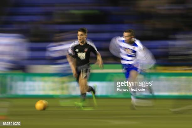 Sergi Canos of Brentford and Jordon Mutch of Reading in action during the Sky Bet Championship match between Reading and Brentford at Madejski...