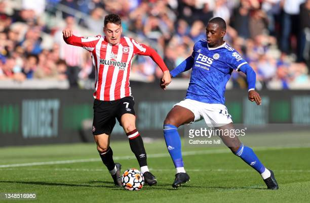 Sergi Canos of Brentford battles for possession with Boubakary Soumare of Leicester City during the Premier League match between Brentford and...