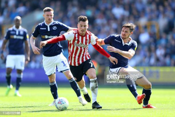 Sergi Canos of Brentford battles for possession with Ryan Tunnicliffe of Millwall and Ryan Leonard of Millwall during the Sky Bet Championship match...