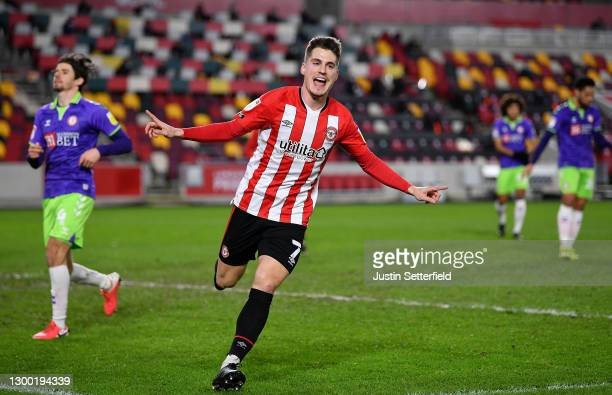 Sergi Canos of Brentford celebrates after scoring their side's first goal during the Sky Bet Championship match between Brentford and Bristol City at...
