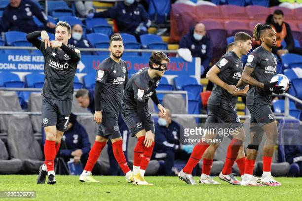 Sergi Canos of Brentford celebrates his goal during the Sky Bet Championship match between Cardiff City and Brentford at the Cardiff City Stadium on...