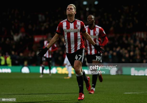 Sergi Canos of Brentford celebrates scoring his sides first goal during the Sky Bet Championship match between Brentford and Fulham at Griffin Park...