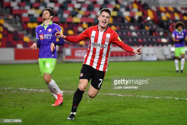 Sergi Canos of Brentford celebrates scoring the first Brentford goal during the Sky Bet Championship match between Brentford and Bristol City at...