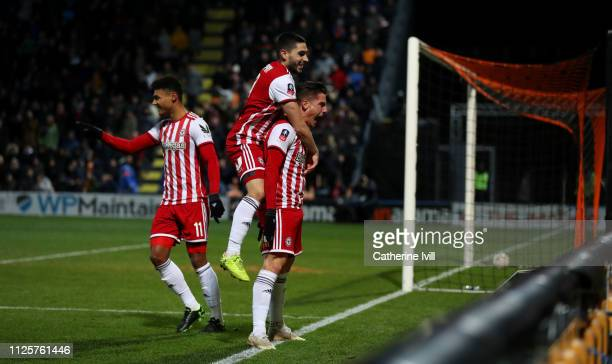 Sergi Canos of Brentford celebrates with Neal Maupay after scoring his team's third goal during the FA Cup Fourth Round match between Barnet and...