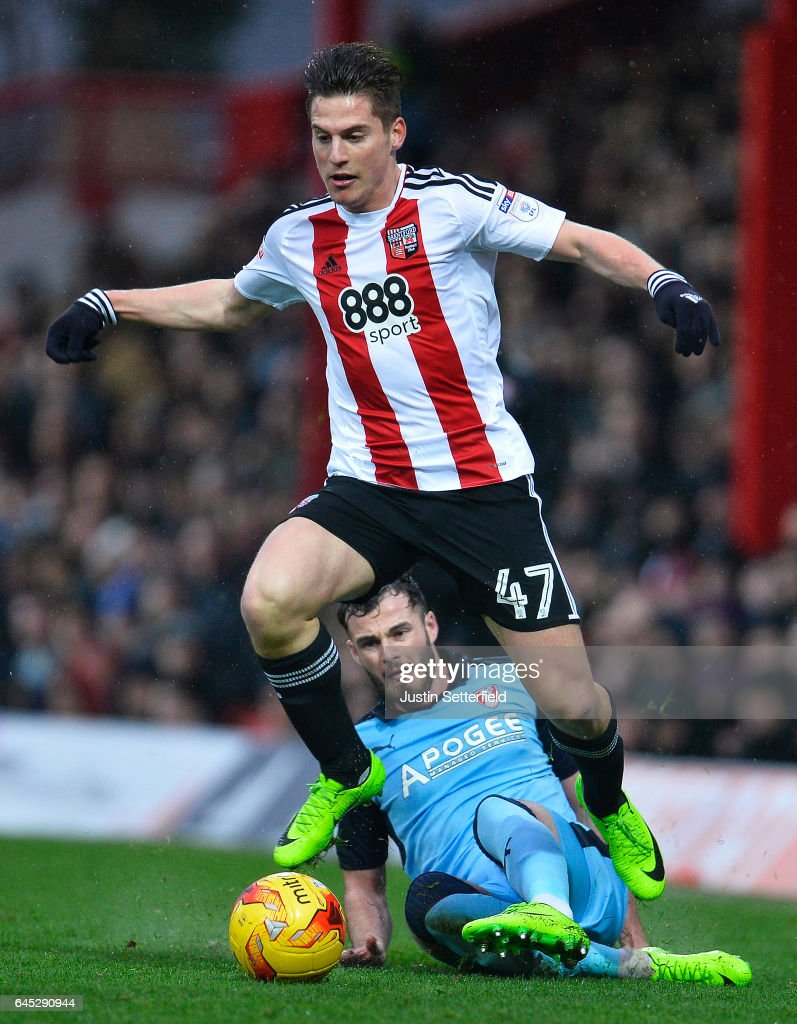 Sergi Canos of Brentford FC and Anthony Forde of Rotherham during the Sky Bet Championship match between Brentford and Rotherham at Griffin Park on February 25, 2017 in Brentford, England.