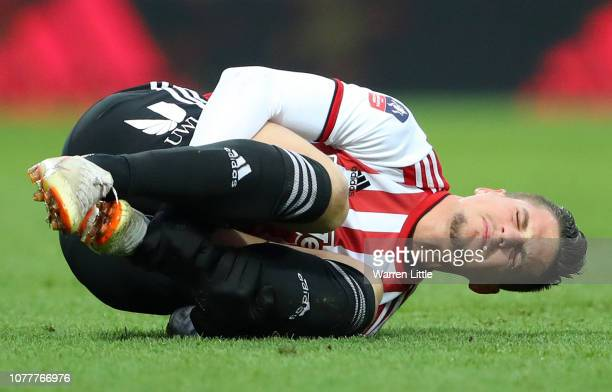 Sergi Canos of Brentford goes down holding his ankle during the FA Cup Third Round match between Brentford and Oxford United at Griffin Park on...