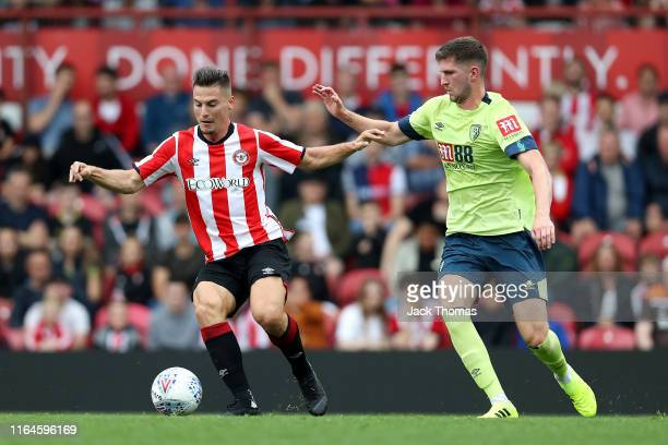 Sergi Canos of Brentford is challenged by Chris Mepham of AFC Bournemouth during the Pre-Season Friendly match between Brentford and AFC Bournemouth...