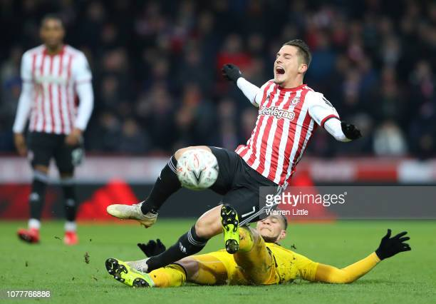 Sergi Canos of Brentford is fouled by Marcus Browne of Oxford United during the FA Cup Third Round match between Brentford and Oxford United at...