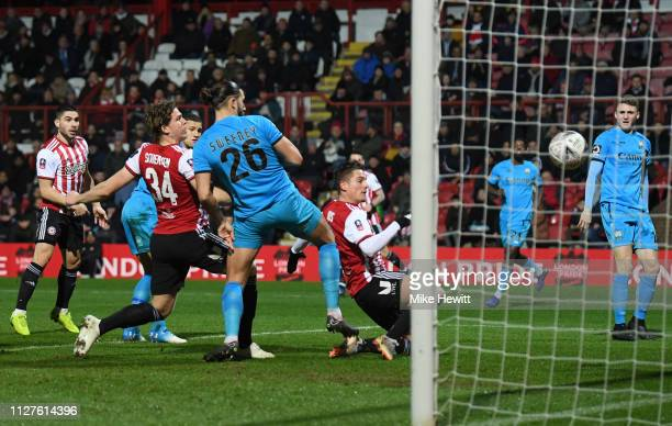 Sergi Canos of Brentford scores his sides first goal during the FA Cup Fourth Round Replay match between Brentford and Barnet at Griffin Park on...