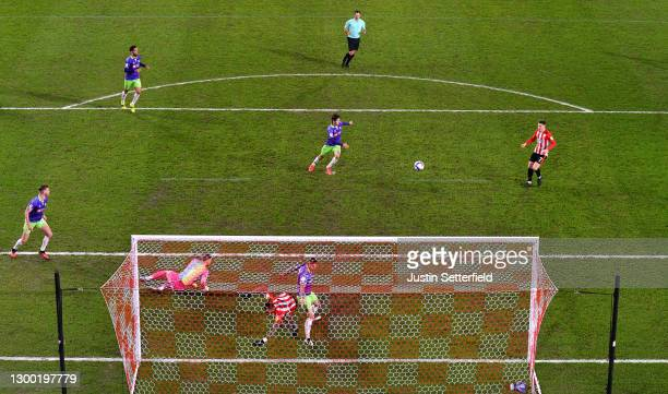 Sergi Canos of Brentford scores their side's first goal past Daniel Bentley of Bristol City during the Sky Bet Championship match between Brentford...