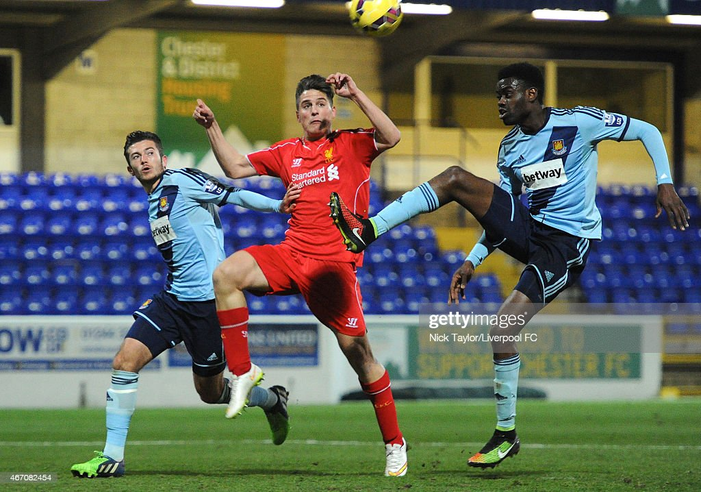 Sergi Canos of Liverpool and Lewis Page and Emmanuel Onariase of West Ham United in action during the U21 Premier League game between Liverpool and West Ham United at The Swansway Chester Stadium on March 20, 2015 in Chester, England.