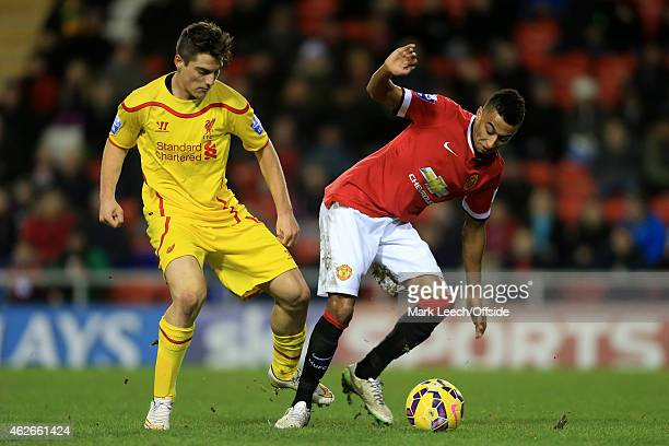 Sergi Canos of Liverpool battles with Jesse Lingard of Man Utd during the Barclays U21 Premier League match between Manchester United and Liverpool...