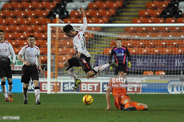 Sergi Canos of Liverpool rides a challenge from Mark Waddington of Blackpool during the FA Youth Cup Third Round fixture between Blackpool and...