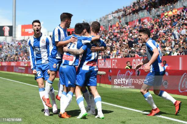 Sergi Darder Moll of RCD Espanyol celebrates after scoring his team's first goal with his team mates during the La Liga match between Girona FC and...