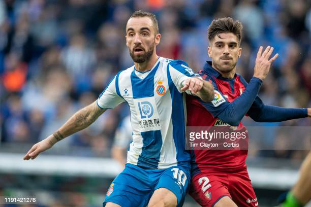Sergi Darder of Espanyol defended by Nacho Vidal of Osasuna during the Espanyol V Osasuna La Liga regular season match at RCDE Stadium on December...