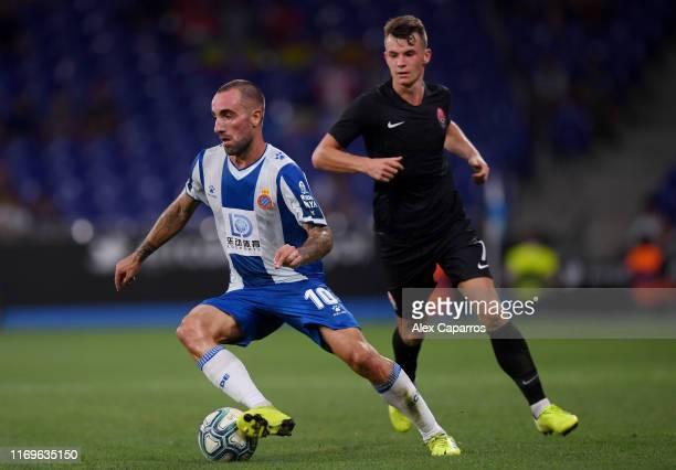 Sergi Darder of Espanyol runs with the ball under pressure from Vladyslav Kocherhin of Zorya Luhansk during the UEFA Europa League Play Off match...
