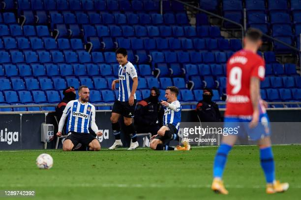 Sergi Darder of RCD Espanyol celebrates with Wu Lei and Adria Pedrosa after scoring his team's second goal during the LaLiga SmartBank match between...