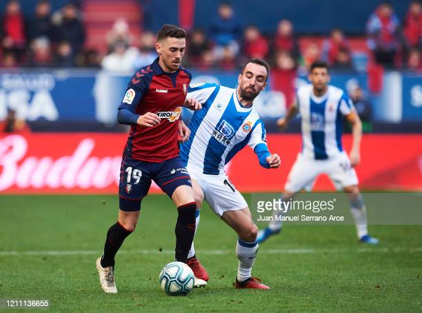 Sergi Darder of RCD Espanyol duels for the ball with Kike Barja of CA Osasuna during the Liga match between CA Osasuna and RCD Espanyol at El Sadar...