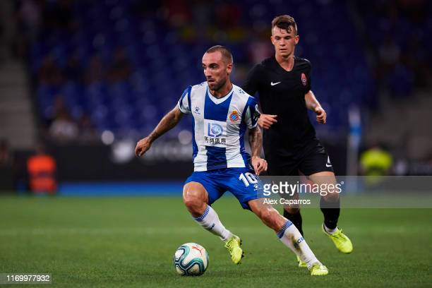 Sergi Darder of RCD Espanyol runs with the ball under pressure from Vladyslav Kochergin of Zorya Luhansk during the UEFA Europa League Play Off match...