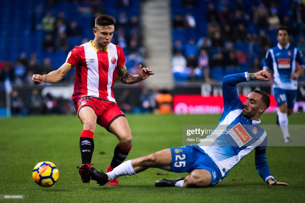 Sergi Darder of RCD Espanyol tackles Pablo Maffeo of Girona FC during the La Liga match between RCD Espanyol and Girona FC at RCDE Stadium on December 11, 2017 in Barcelona, Spain.