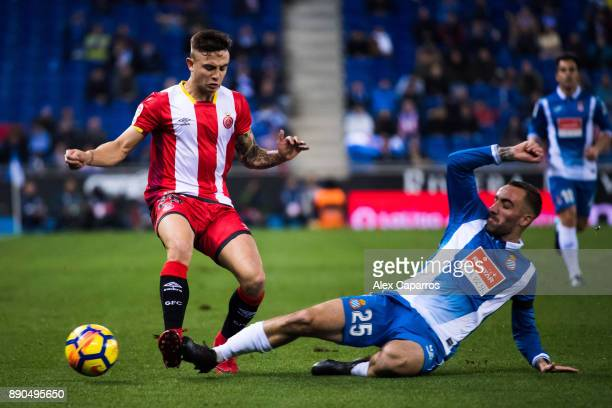 Sergi Darder of RCD Espanyol tackles Pablo Maffeo of Girona FC during the La Liga match between RCD Espanyol and Girona FC at RCDE Stadium on...