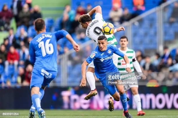 Sergi Enrich Ametller of SD Eibar fights for the ball with Fayçal Fajr of Getafe CF during the La Liga 201718 match between Getafe CF and SD Eibar at...