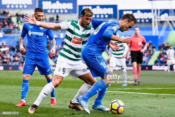 Sergi Enrich Ametller of SD Eibar fights for the ball with Juan Cala of Getafe CF during the La Liga 201718 match between Getafe CF and SD Eibar at...