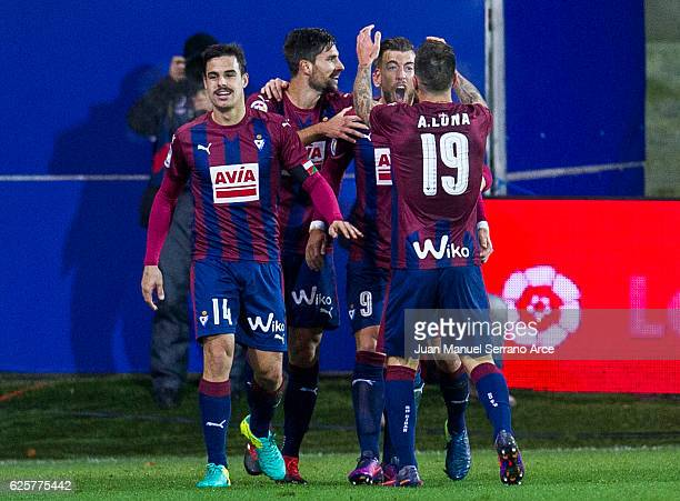Sergi Enrich of SD Eibar celebrates with his teammates Antonio Luna and Adrian Gonzalez of SD Eibar after scoring his team's second goal during the...