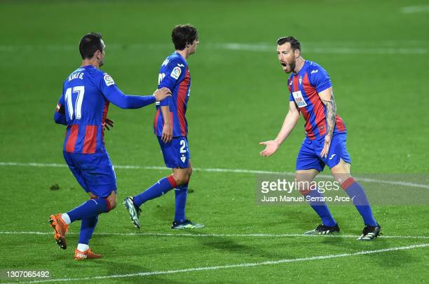 Sergi Enrich of SD Eibar celebrates with team mates after scoring their side's first goal during the La Liga Santander match between SD Eibar and...