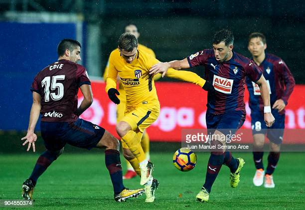 Sergi Enrich of SD Eibar duels for the ball with Antoine Griezmann of Atletico Madrid during the La Liga match between SD Eibar and Atletico Madrid...