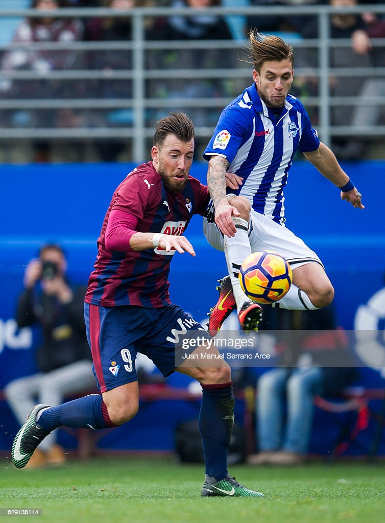Sergi Enrich of SD Eibar duels for the ball with Francisco Femenia of Deportivo Alaves during the La Liga match between SD Eibar and Deportivo Alaves at Ipurua Municipal Stadium on December 11, 2016 in Eibar, Spain.