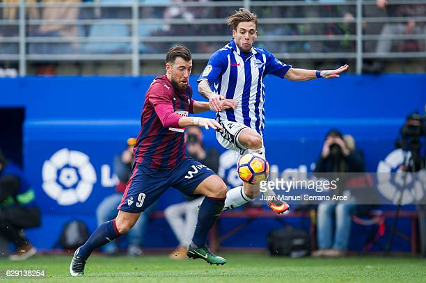 Sergi Enrich of SD Eibar duels for the ball with Francisco Femenia of Deportivo Alaves during the La Liga match between SD Eibar and Deportivo Alaves...