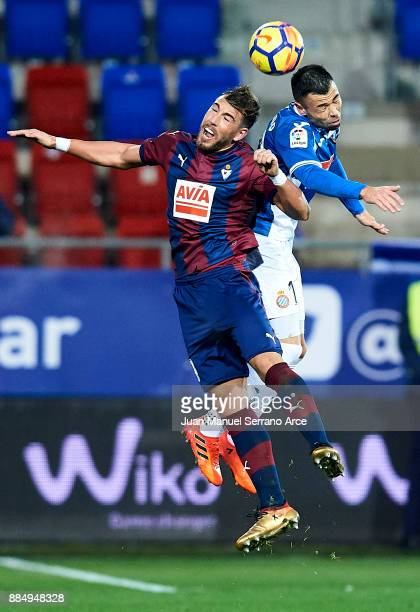 Sergi Enrich of SD Eibar duels for the ball with Javier Fuego Martinez of RCD Espanyol during the La Liga match between SD Eibar and RCD Espanyol at...