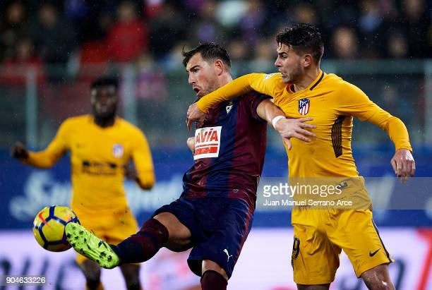 Sergi Enrich of SD Eibar duels for the ball with Lucas Hernandez of Atletico Madrid during the La Liga match between SD Eibar and Atletico Madrid at...