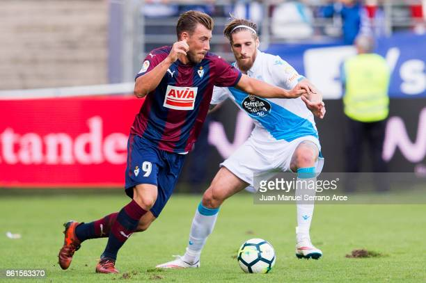 Sergi Enrich of SD Eibar duels for the ball with Raul Albentosa of RC Deportivo La Coruna during the La Liga match between SD Eibar and RC Deportivo...