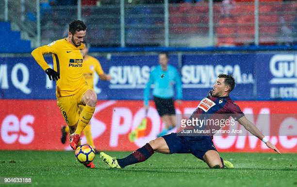 Sergi Enrich of SD Eibar duels for the ball with Saul Niguiz of Atletico Madrid during the La Liga match between SD Eibar and Atletico Madrid at...