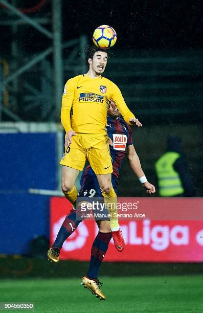 Sergi Enrich of SD Eibar duels for the ball with Sime Vrsaljko of Atletico Madrid during the La Liga match between SD Eibar and Atletico Madrid at...