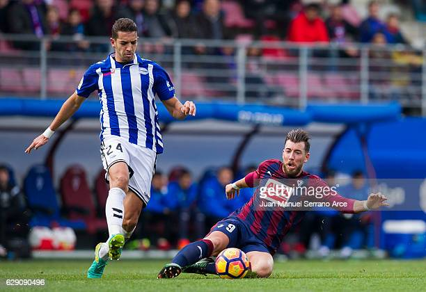 Sergi Enrich of SD Eibar duels for the ball with Zouhair Feddal of Deportivo Alaves during the La Liga match between SD Eibar and Deportivo Alaves at...