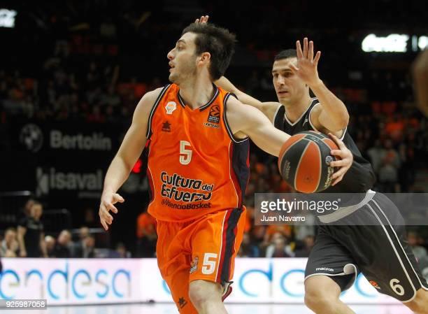 Sergi Garcia #5 of Valencia Basket competes with Nikos Zisis #6 of Brose Bamberg during the 2017/2018 Turkish Airlines EuroLeague Regular Season...