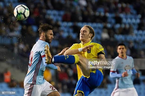 Sergi Gomez of Celta de Vigo competes for the ball with Alen Halilovic of UD Las Palmas during the La Liga match between Celta de Vigo and Las Palmas...