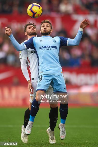 Sergi Gomez of Sevilla FC competes for the ball with Cristian Portugues 'Portu' of Girona FC during the La Liga match between Sevilla FC and Girona...