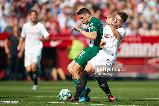 Sergi Gomez of Sevilla FC competes for the ball with Jonathan Calleri of RCD Espanyol during the Liga match between Sevilla FC and RCD Espanyol at...