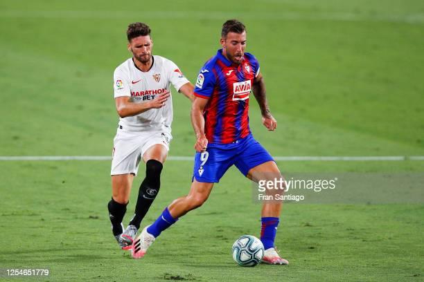 Sergi Gomez of Sevilla FC competes for the ball with Sergi Enrich of SD Eibar during the Liga match between Sevilla FC and SD Eibar SAD at Estadio...